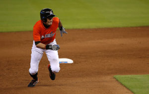 MIAMI, FL - JUNE 14: Ichiro Suzuki #51 of the Miami Marlins steals third during a game against the Colorado Rockies at Marlins Park on June 14, 2015 in Miami, Florida. (Photo by Mike Ehrmann/Getty Images)